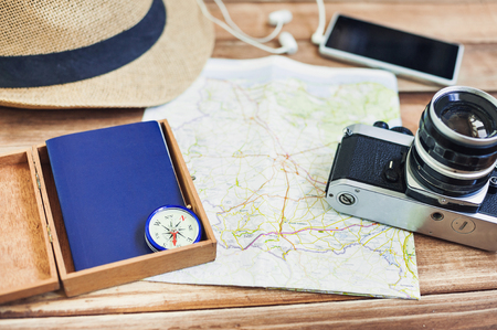 old items: Accessories for travel. Passport, photo camera, smart phone and travel map. Top view. Holidays and tourism concept Stock Photo