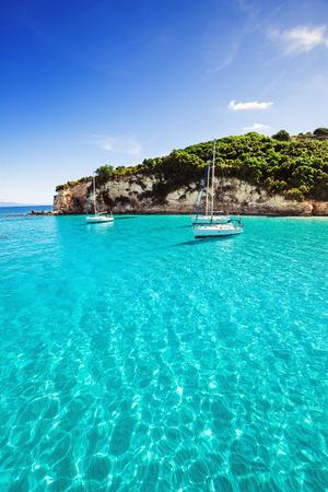 Sailboats in a beautiful bay, Paxos island, Greece