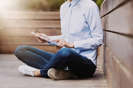 Young student girl using digital tablet outdoors Stock Photo