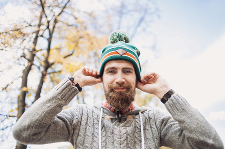 Handsome young man wearing warm clothes outdoors portrait