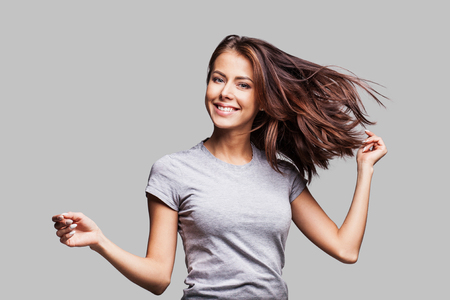 Pretty girl with long hair laughing, dancing and enjoying life Stock Photo
