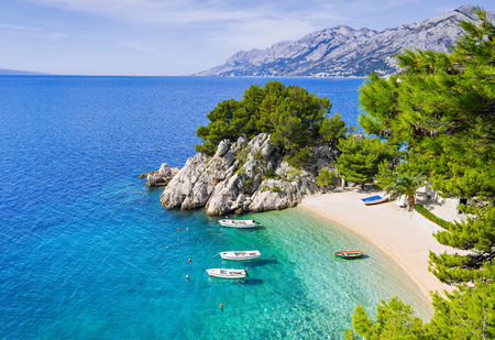 Beautiful beach near Brela town, Dalmatia, Croatia. Makarska riviera, famous landmark and travel touristic destination in Europe Фото со стока
