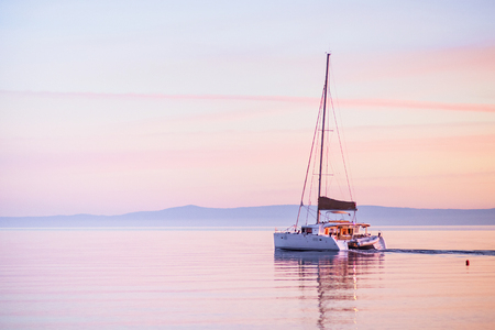 Sailing yacht in Mediterranean sea at sunset. Travel and active lifestyle concept