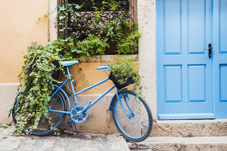 Old rusty bike leaning against a wall. Vintage retro bicycle. Mediterranean style