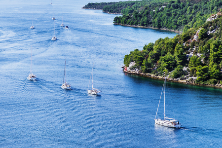 Beautiful bay with sailing boats, Croatia. Yachting sail boats near the croatian islands. Travel, sport and active lifestyle concept