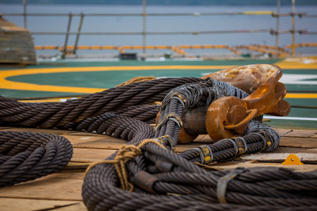 helideck: Cables and hook on an oil rig helideck