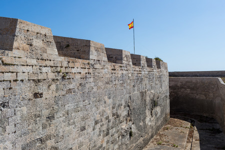 baleares: Mediterranean fort wall with its flag