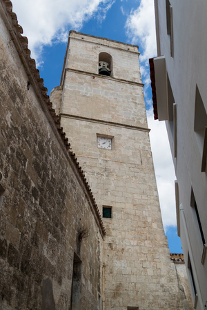 baleares: Church and its tower bell under a cloudy blue sky
