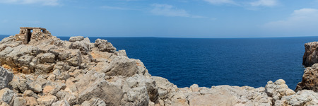 Panoramic view of an old stone shelter above the sea Stock Photo
