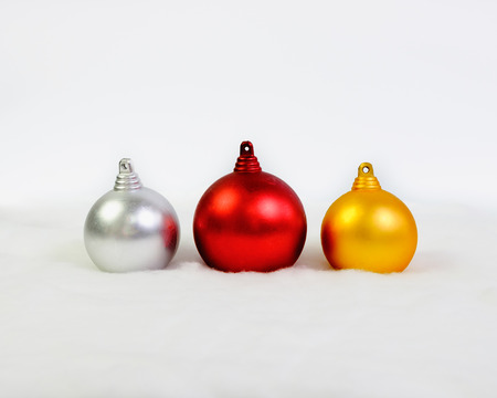 Three christmas balls on white background.