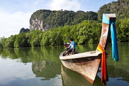 Long tail boat arriving at Tarnboke Koranee Aoluk District National Park, Krabi Province, Thailand