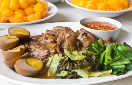 Stewed pork leg with five spices, served with eggs and pickle, Thai food Stock Photo
