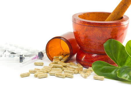 prescribe: Mortar and pestle with herb capsules spilling out of bottle