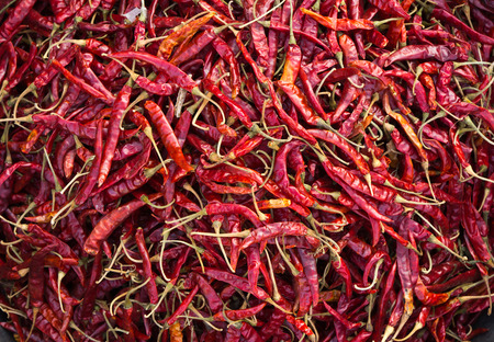 A heap of spicy red hot chili peppers, top view Stock Photo