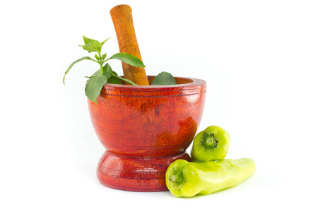 Fresh herbs and spices with wooden mortar