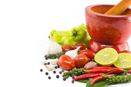 Fresh herbs and spices with wooden mortar  Stockfoto