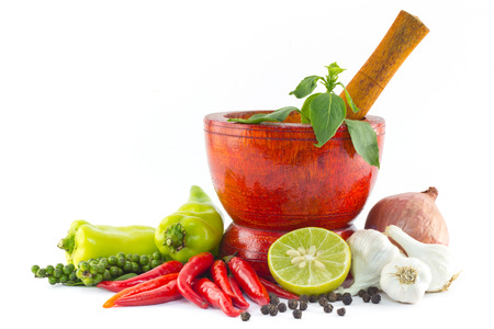 thai pepper: Fresh herbs and spices with wooden mortar  Stock Photo