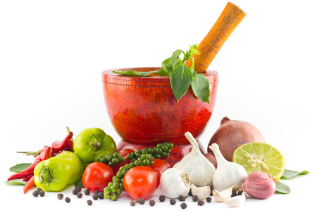 pounder: Fresh herbs and spices with wooden mortar  Stock Photo