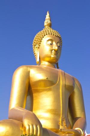 adore: ig Buddha image on blue sky background  Stock Photo
