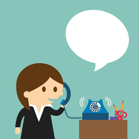 Businesswoman speaking into a telephone