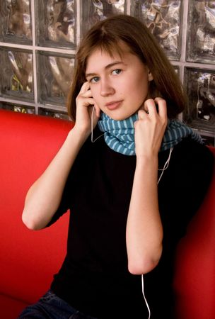 Girl in Blue Scarf Listening Music photo