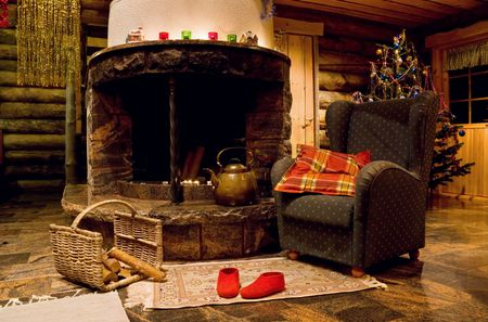 log wall: Christmas living room with fireplace and armchair