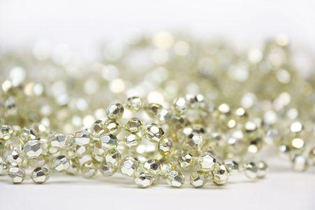 Golden decoration beads lying on white background photo
