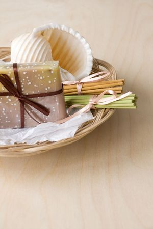 spliced: Basket with handmade soap, aromatic sticks and shell Stock Photo