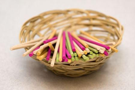 spliced: Colored aromatic sticks in basket