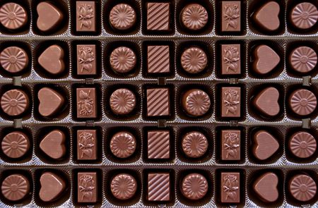 Box with chocolate candies' rows Stock Photo - 7165960