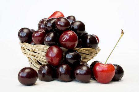 spliced: Red cherries in spliced basket Stock Photo