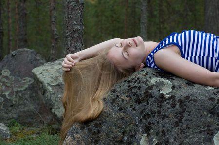 Woman lying on the big stone photo