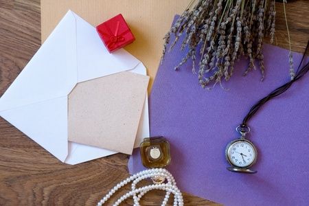 Paper composition with perfume bottle, gift box, lavender and pocket watch photo
