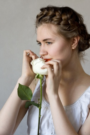 Girl and white rose photo