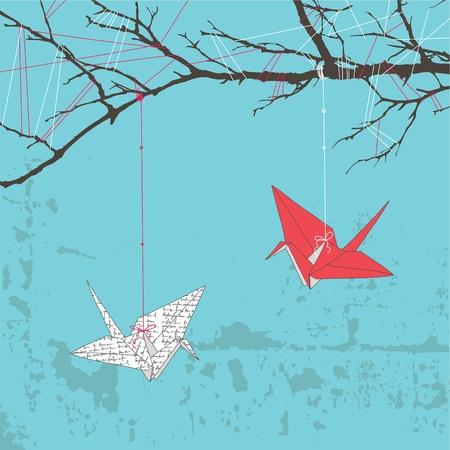 Dos grullas de papel colgando de rama de árbol