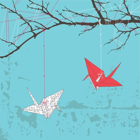 origami bird: Two paper cranes hanging on tree branch