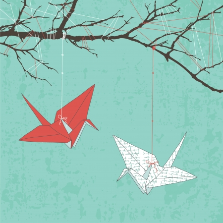 crane origami: Two paper cranes hanging on tree branch