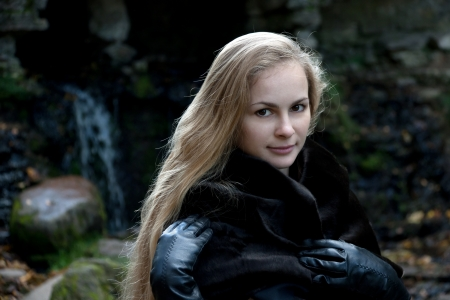 long gloves: Portrait of young woman in black fur coat Stock Photo