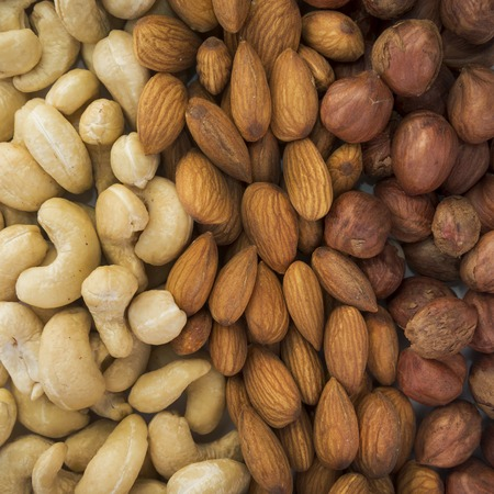cashews: clean almonds, hazelnuts, cashews nuts mixed together Stock Photo