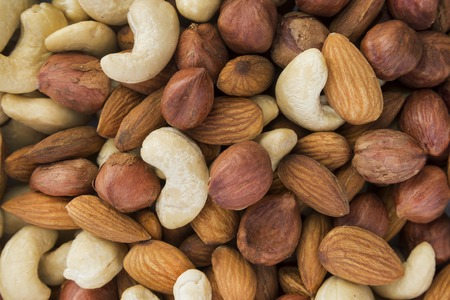 pine kernels: clean almonds, hazelnuts, cashews nuts mixed together Stock Photo