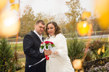 newly: Newly married couple posing in autumn park