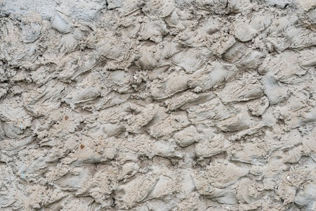 scabrous: rough cement the wall with scabrous strokes Stock Photo