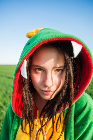 Girl dragon kigurumi with dreadlocks Stock Photo