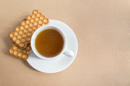rooibos: White cup of tea with biscuits Stock Photo
