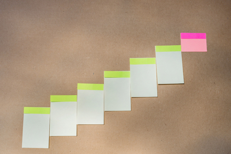 pinning: Horizontal board with many white sticky notes pinned
