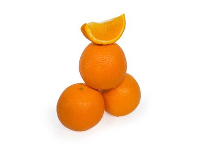 Three oranges and slice isolated