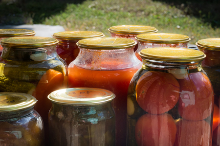 Jars with variety of pickled vegetables. Preservation Stock Photo
