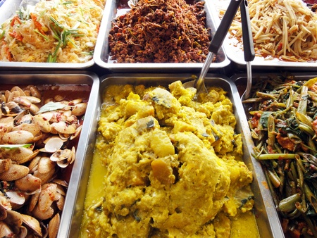 Many kind of Thai food in fresh market, Thai food is generally cooked with many herbs and good for health. photo