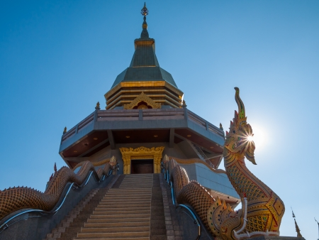 Golden Pagoda on blue sky backgound in sunny day photo