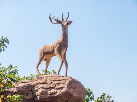 A photo of deer statue on blueskies photo
